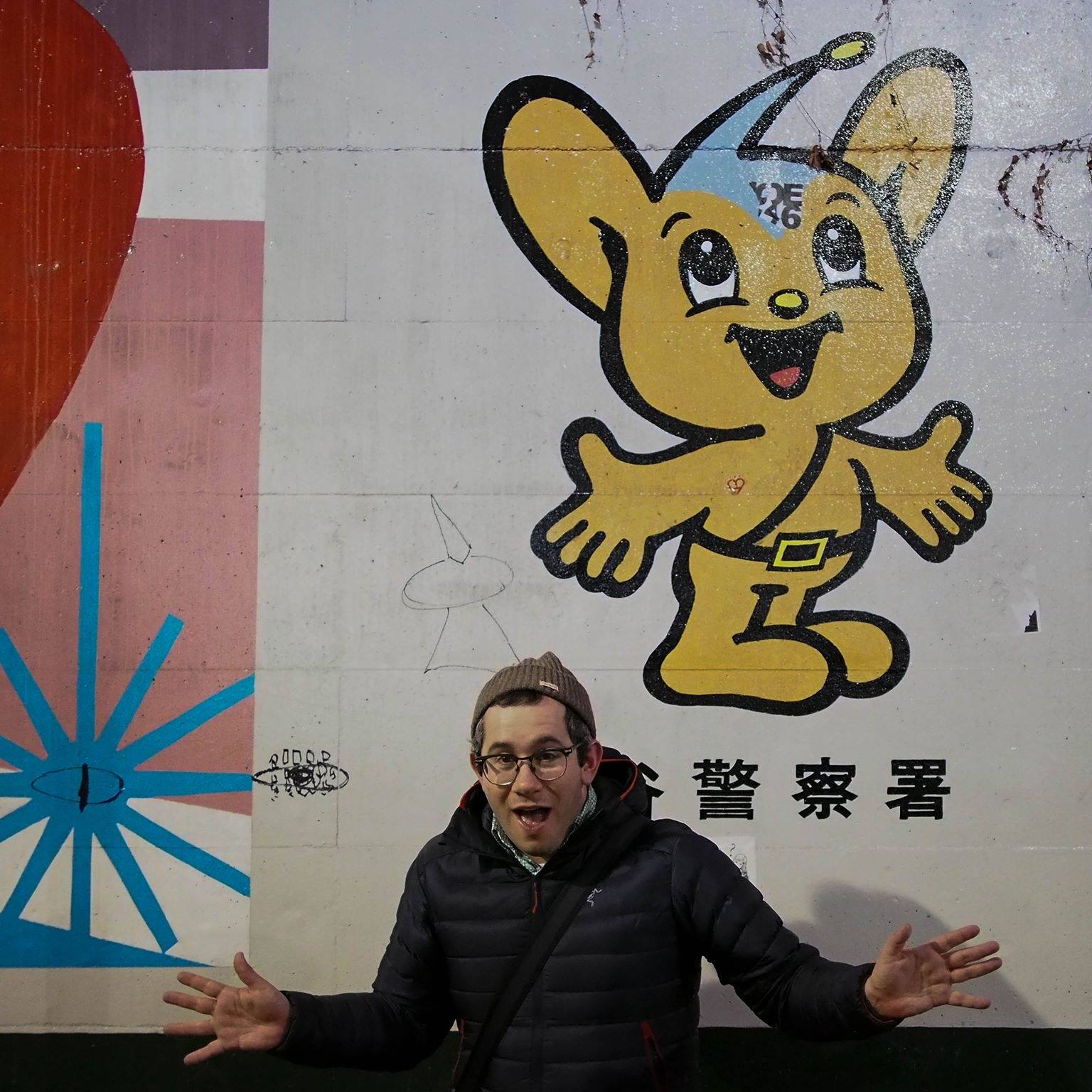 Simon in Tokyo with the police mascot